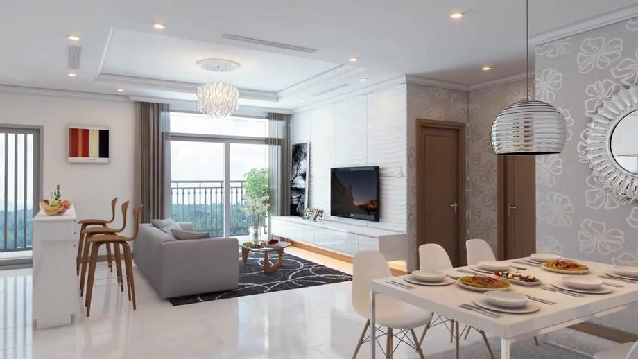 Khu vực ăn có bộ bàn ghế ăn cho 6 người hiện đại tông màu trắng, tường trang trí giấy dán tường là chiếc gương tròn độc đáo.